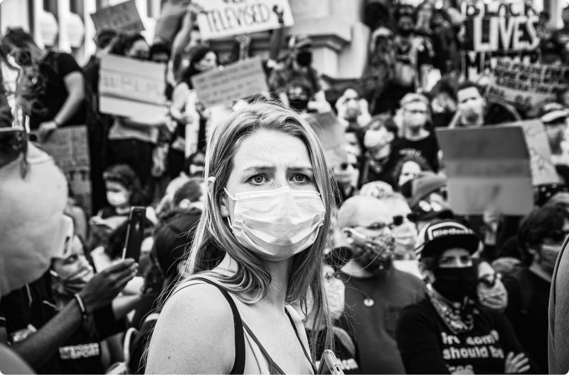 girl wearing a mask in a crowd